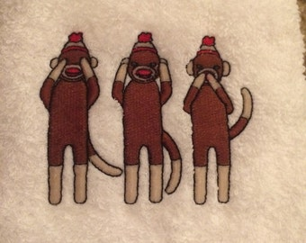 Monkeys embroidered on a hand towel