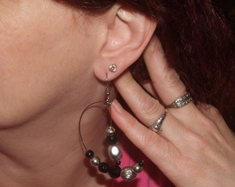 "Silver-tone 1 1/2"" long earrings w/ rose-shaped silver-tone and glass beads, and silver-tone beads suspended from center post."