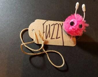 FUZZY is a Warm Fuzzy Friend Powder Puff Poof