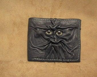 Grichels leather bi-fold wallet - dark green with lemonade fish eyes