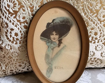 Antique Beautiful Woman In Feather Hat With Bow Art Print by J. Knowles Hare 1909 In Oval Gold Metal Frame, Edwardian Fashion