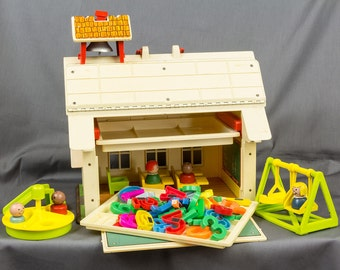 vintage Fisher Price School House, 5 little people, 5 chairs, Swing, Slide, Merry Go Round, Numbers and Letters, 2 trays Very Nice condition
