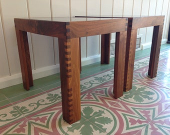 Pair of vintage walnut end tables with exposed dovetail joinery and smoked glass tops