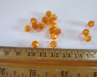 100 no hole balls ,  7mm balls in MOONGLOW ORANGE  BN #23, vintage and priced to sell, craft supply, jewelry findings