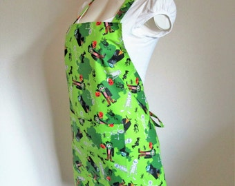 Halloween Apron - A Gorgeous Green Spooky apron filled with Frankensteins, Draculas, Skeletons, cats and bats, a fun party apron