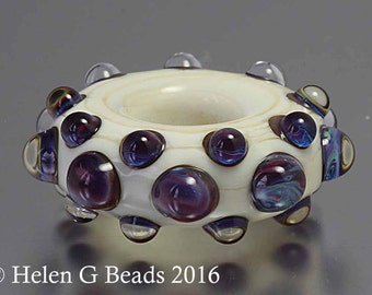 Bumpy, Lampwork Ring or wheel Bead in ivory, purple and blue by Helen Gorick