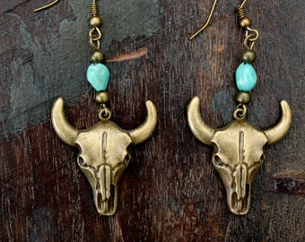 Dangle Bronze Bull Coe skull earrings with a turquoise stone center Boho chic Southwestern Country girl Gypsy Native style designby Inali