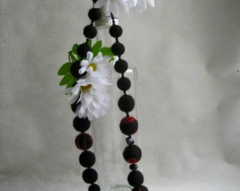 """A felt necklace """"Red on black"""""""