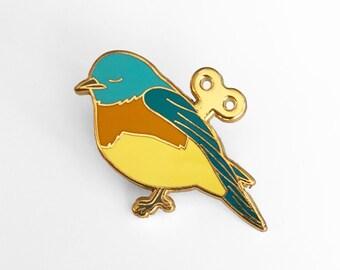 Wind Up Bird Enamel Pin