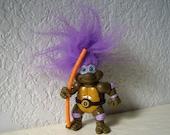 Teenage Mutant Ninja Turtle, Donatello Troll with original accessory. 1993.