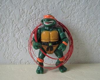 Teenage Mutant Ninja Turtle, Talking Michael Angello with three talking strips, 1991. Rare