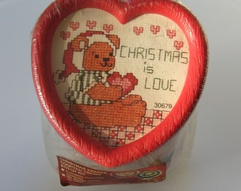 Crafty Keepers Christmas Cross Stitch Kit. Plastic canister cookie jar with red heart lid to stitch. Teddy Bear Christmas is Love pattern.