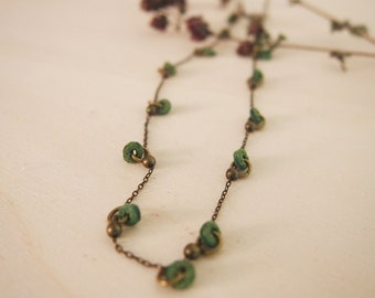 Green necklace with little leather circles, handmade necklace boho style