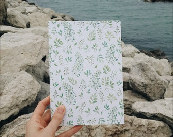 Cute little notebook with floral pattern. Green watercolor leaves on the cover. Perfect gift. Illustration, stationery, diary, journal.