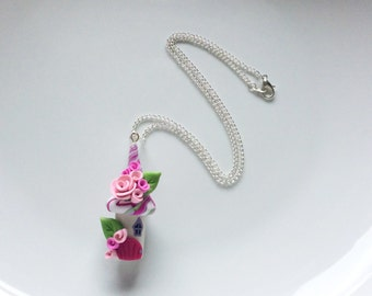 Fairy house necklace in pink colours handmade from polymer clay