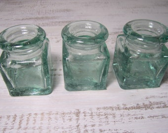 Three hand made petite heavy green glass bubble glass apothecary jars small flower vases