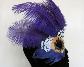 Purple Ostrich Feathers Crown the mask with Lady Amherst feather Accents