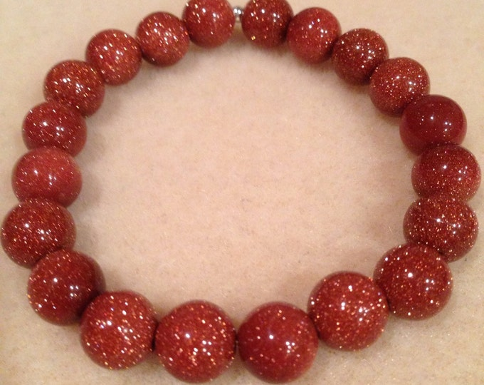 Brown Goldstone 10mm Round Stretch Bead Bracelet with Sterling Silver Accent