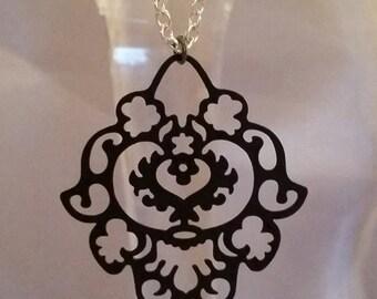 Laser cut filigree floral necklace