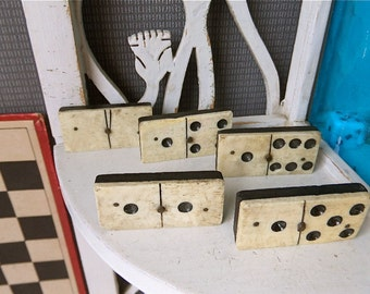 Antique set of dominoes made of white bone and ebony.