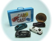 Dolls house miniature, unique little toy car case in blue containing four tiny cars