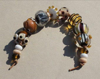 Handmade glass beadset in beige, brown, white, transparant by Flamejewels