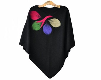 black poncho, colorful leaves