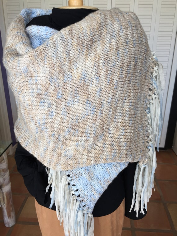 Light blue and soft tan wrap with ribbon fringe.