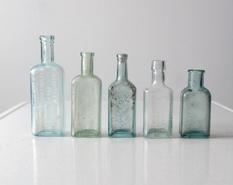 antique apothecary bottle collection, blue glass bottles