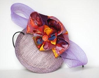 Lilac fascinator with obi belt fabric flower