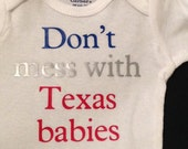 Don't mess with Texas babies onesie