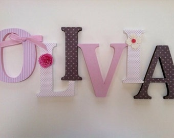 Wooden letters for nursery in pink and brown