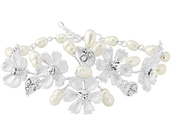 Bridal Bracelet with handpainted ivory flowers and freshwater pearls. Adjustable chain.