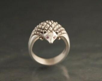 Hedgehog ,diamond eyes.  silver