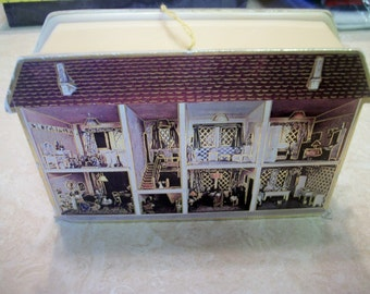 Merrimack Victorian House box, 1981, and Victorian girl paper garland