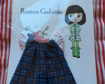 Rosiee Gelutie Dress with Flutterby Sleeves and Floral Trim