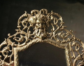 Ornate brass wall sconce, mirror wall sconce