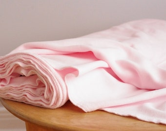 Light pink polar fleece fabric by the yard