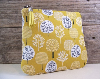 Clutch or Cosmetic bag in a cute yellow tree fabric with tassel and waterproof washable lining - Make up bag or custom bag for wedding.