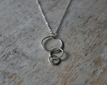 Triple infinity circle sterling silver pendant necklace