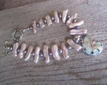 Biwa pearl bracelet, opal shell charm, nautilus charm, freshwater pearl bracelet, oceanic design jewelry