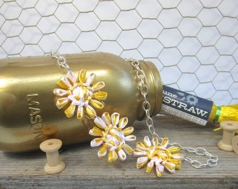 Sally long flower necklace woven in bright sunshine yellow and perfect white with vintage Swistraw by Ruby Buffalo.
