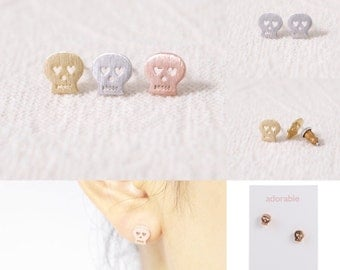 SKULL >> rose gold studs << day of dead >> halloween type scary but totes not cuz of those cute heart eyes >> donates to Humane Society