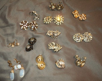 13 Pairs of Rhinestone Earrings,  13 matching pairs and one without a match, all in  Good Condition which would make a great bridal bouquet