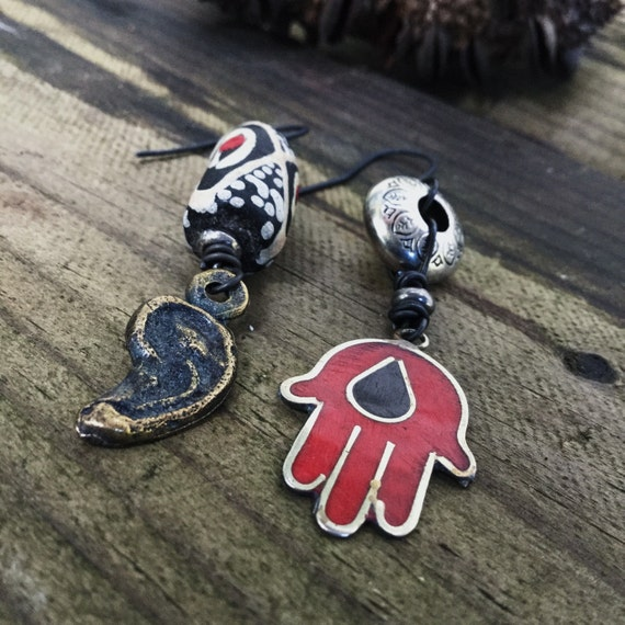 Rustic earrings with Hamsa and Mexican Milagros and African trade bead | asymmetric drop earrings, red and black