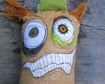 Clive, the ginger monster trucker handmade art doll