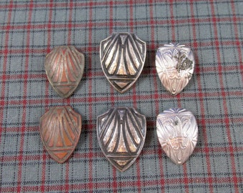 Three Pairs of Shoe Button Covers
