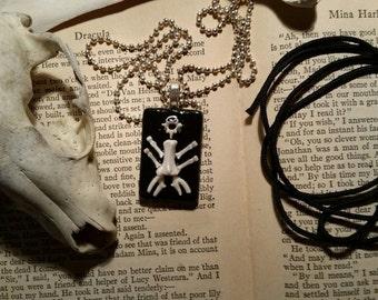 bones.bone doodle. glass pendant. bone figure.