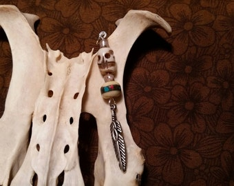 bone pendant. bone skull bead. mala bead. feather charm.