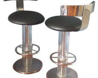 pair of chrome and lucite swivel stools by design for leisure